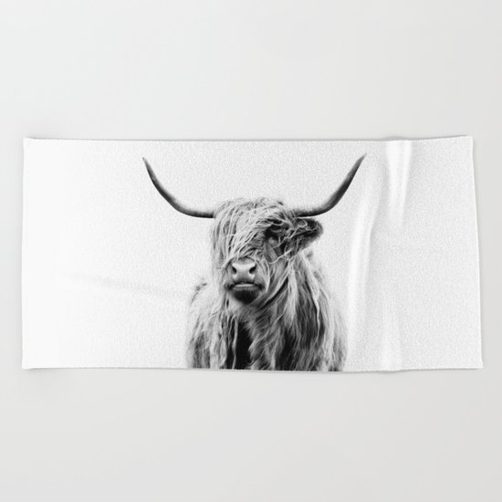 portrait of a highland cow Beach Towel