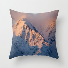 Sunset behind the snowy mountain Throw Pillow