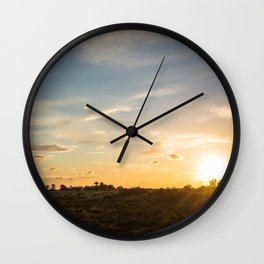 Ocaso en la marisma Wall Clock