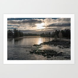 Riverscape in morning light with trees, rocks, sky and clouds Art Print