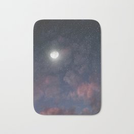 Glowing Moon on the night sky through pink clouds Bath Mat
