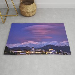Lenticular clouds over Granada, The Alhambra, Albaicin village and Sierra Nevada. At sunset Rug