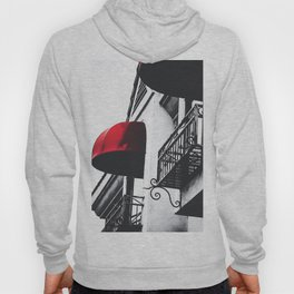 building with porch and red awning in the city Hoody