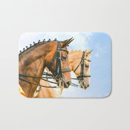 Side view portrait of two braided horses, blue sky as a background. Bath Mat