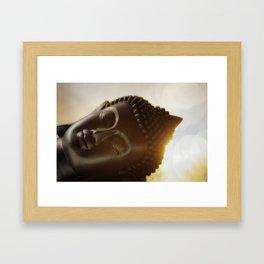 The silhouette of a Buddha head in Sunrise Framed Art Print