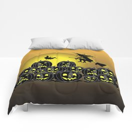 Pumpkins and witch in front of a full moon Comforters
