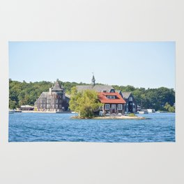 One Island with a small house in Thousand Islands Region in summer in Kingston, Ontario, Canada Rug