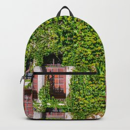 Creeper ivy plant on old stone medieval wall with window surreal kaleidoscope pattern Backpack