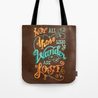 not all those who wander are lost Tote Bags featuring Not All Those Who Wander Are Lost by becca cahan