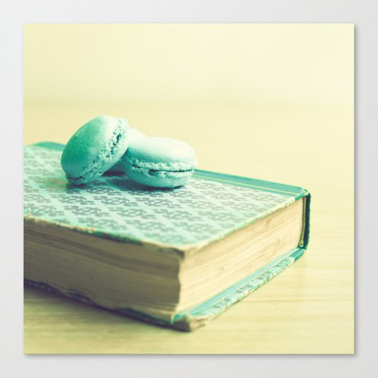 Blue macaroons over book Canvas Print