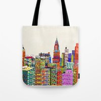 new york skyline Tote Bags featuring new york city skyline by bri.buckley