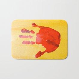 A red hand Bath Mat