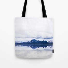 Navy blue Mountains Against Lake With Clouds Tote Bag