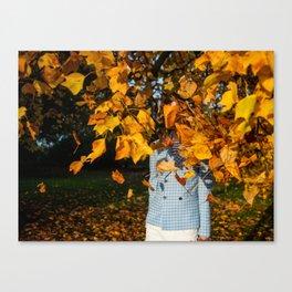 Autumn portrait behind golden leaves Canvas Print