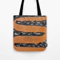 river Tote Bags featuring river by crayon dreamer