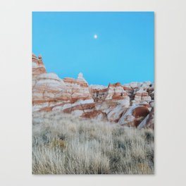 Moon Over Marbled Rock Formation Canvas Print