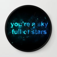 coldplay Wall Clocks featuring Sky Full of Stars by Berlyn Komar