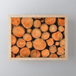 stack of wood Framed Mini Art Print