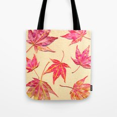 Japanese maple leaves - coral red on pale yellow Tote Bag
