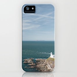 Lighthouse at Hartland Quay with Lundy Island beyond. Devon, UK. iPhone Case