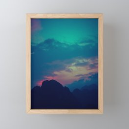 Blue and pink evening sky over the limestone mountains in the Vang Vieng province in Laos. Framed Mini Art Print