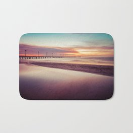 Minimalist sunset seascape at low tide with long pier Bath Mat