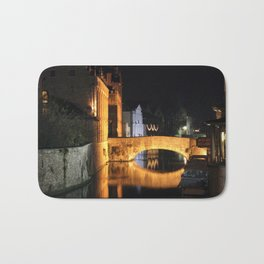 beautiful bridge at night time in bruges Bath Mat