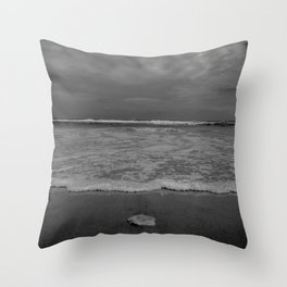 A lonely sea shell in the surf of Assateague Island (black and white) Throw Pillow