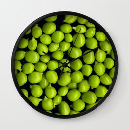 Texture and background of green peas on a black background Wall Clock