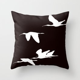 White Silhouette of Glossy Ibises In Flight Throw Pillow