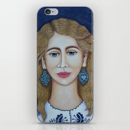 Woman with silver earrings iPhone Skin