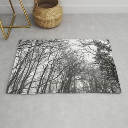 Black and white misty forest Rug