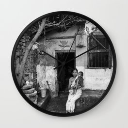 Mother and daughter by the doorway Wall Clock