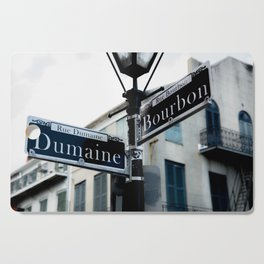 Dumaine and Bourbon - Street Sign in New Orleans French Quarter Cutting Board