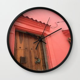 Cartagena is Peachy, Colombia, South America. Coral Pink Building with Ornate Lizard design Wall Clock