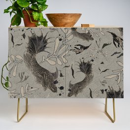 Lost. It's where she feels at ease. Credenza