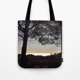 Golden Peach Glowing Ocean Unfiltered Seascape With Tree Silhouettes Tote Bag