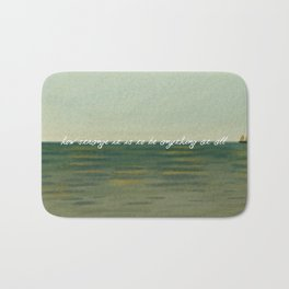 How strange it is to be anything at all Bath Mat