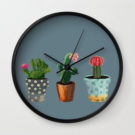 Three Cacti With Flowers On Blue Background Wall Clock