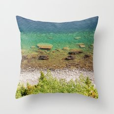 Stone shore on the lake in Canada Throw Pillow