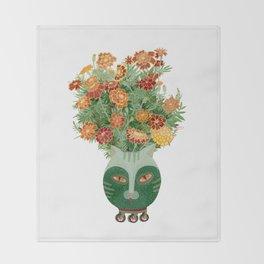 Marigolds in cat face vase  Throw Blanket