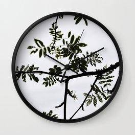 Rowan branch against the sky Wall Clock