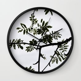 Rowan branch against the sky Wall Clock
