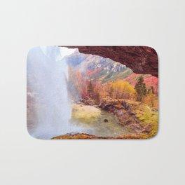 Waterfall in an autumn day in the italian alps Bath Mat
