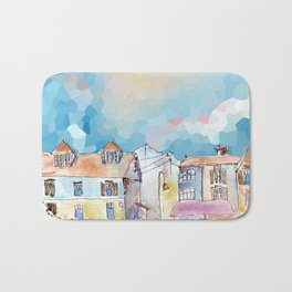 Colorful street in old town under abstract sky Bath Mat