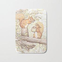 Squirrels collecting nuts Bath Mat