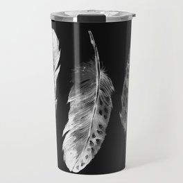 Three feathers on black background Travel Mug