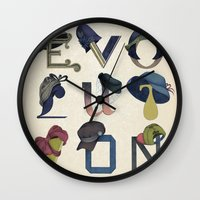 hats Wall Clocks featuring Evolution / Hats by Katia Engell Illustration