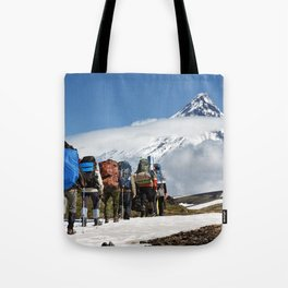 Group of hikers climbing on mountain on background volcanoes of Kamchatka Peninsula Tote Bag