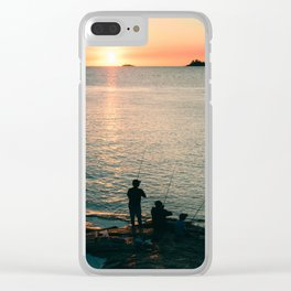 Three fisherman enjoy a beautiful sunset at the shore of 'Colonia del Sacramento, Uruguay'. Clear iPhone Case